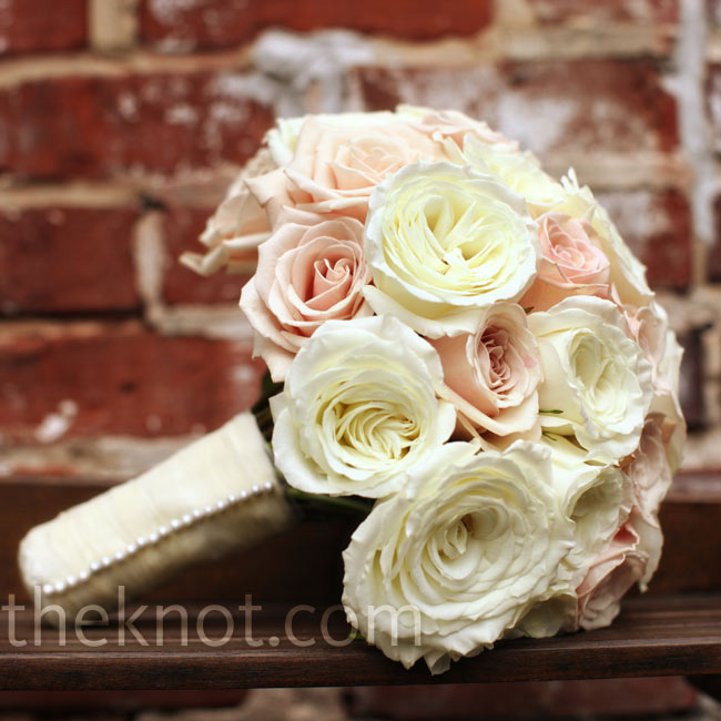 Following the summer romance theme, Heather carried a classic bouquet of vintage blush and snowy jewel roses with the stems wrapped in ivory satin.
