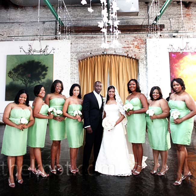 Heather chose soft clover-green bridesmaid dresses to complement her romantic, summer style. The strapless dresses were made of Eastern silk shantung and stopped right at the knee.