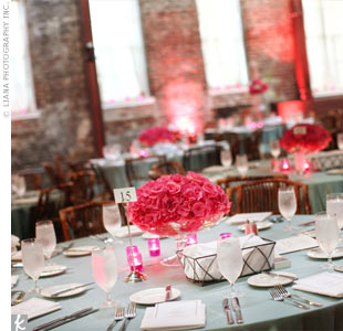 Dark pink hydrangeas and roses stood out against the blue lamour-draped tables. Ambient candlelight added a romantic touch.