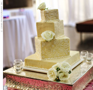 The couple cut into a beautiful, staggered-tiered cake with delicate lace icing that matched the pattern in the bridal gown.
