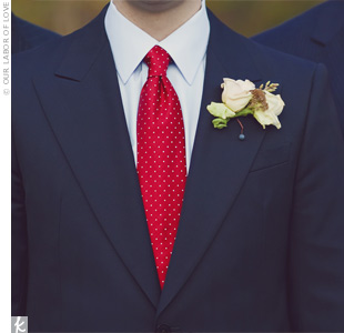 The guys all wore cream-colored spray roses accented with berries -- a subtle touch to their bold navy suits and red ties.