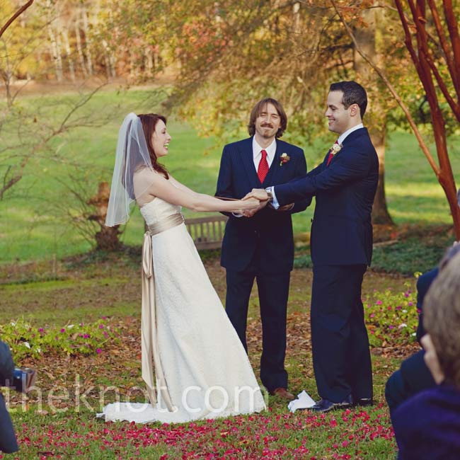 During rehearsal the couple realized the sun would be right in their guests' eyes, so they quickly changed locations and exchanged vows near a patch of gardens and trees full of bright yellow foliage.