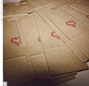 Lindsey and Jeff decorated paper bags with heart stamps and laid them out for guests to fill with the candy favors.