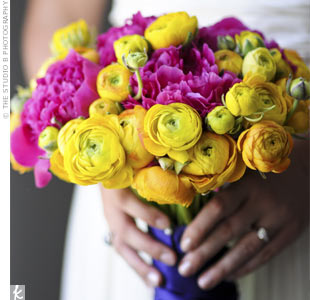 Martha used her favorite flowers, peonies, in a hot pink shade and filled out the rest of her bouquet with vibrant yellow and orange ranunculus.