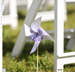 The bride walked down an aisle lined with multicolored pinwheels spinning in the breeze.