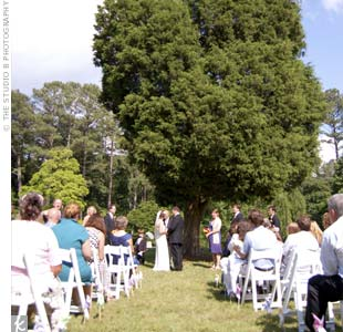 The bride and groom were married beneath a large tree in the rose garden at Smith-Gilbert Gardens.