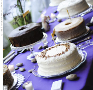 The cake table displayed eight different confections from a local bakery. They had no fussy decorations but were simple and beautiful...not to mention delicious, says the bride.