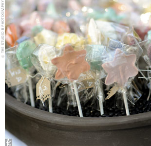 Martha and Erich gave their guests chocolate flower lollipops and displayed them in a Bonsai pot filled with black beans.