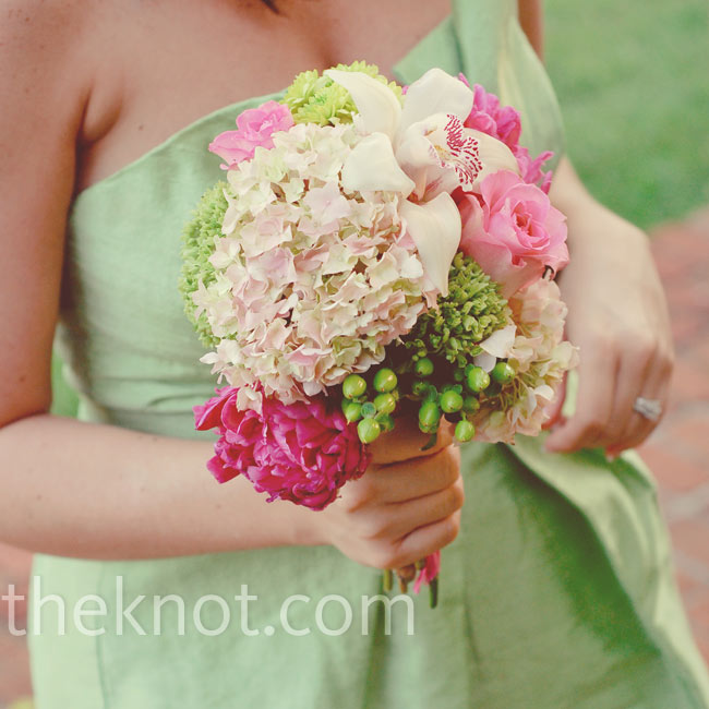Brooke's bridesmaids carried romantic bouquets of pink orchids, hydrangeas, peonies, and roses along with pops of green.
