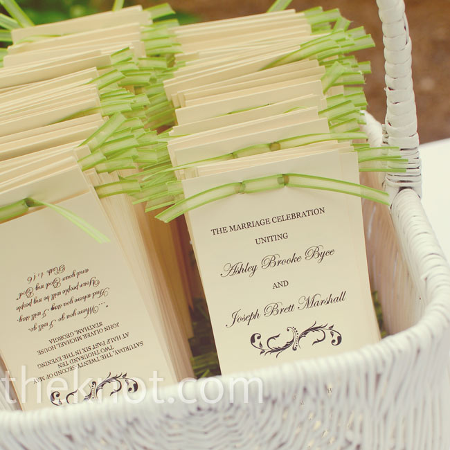 Bright green ribbon added a shot of color to the classic handmade ceremony programs.