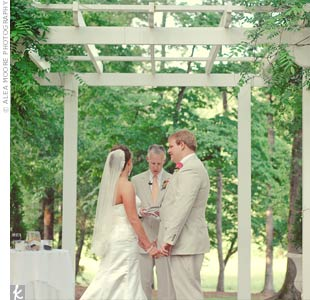 Brooke and Brett exchanged vows beneath an arbor at sunset on the lawn of the John Olive Michael House.
