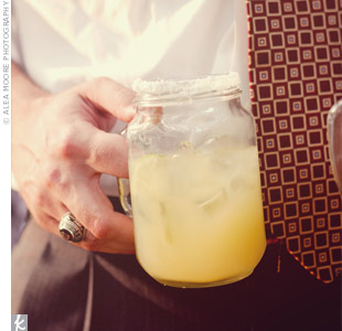 "Guests sipped on ""Marry Me Margaritas"" served in sugar-rimmed Mason jars."