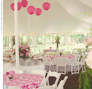 Pink damask fabric and large pink paper lanterns gave the white reception tent a burst of color and texture.