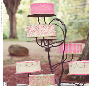 """We love cake,"" says the bride. The couple served several different cakes decorated in pink-and-green swirls, stripes, and dots."