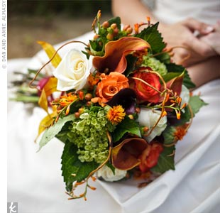 The bride carried a beautifully structured bouquet of calla lilies, roses, and hydrangeas in rich autumn colors.