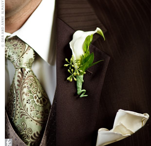 The groomsmen wore ivory mini calla lilies with small clusters of berries in contrast with Bill's orange calla lily boutonniere.
