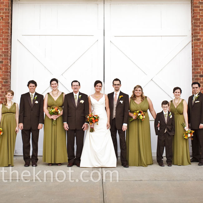 Erin's four bridesmaids wore flowing jersey gowns with satin detailing in fern green.