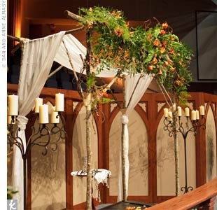 For an intimate, woodsy feel, the huppah was made of branches, autumn flowers, and leaves and draped in ivory fabric.