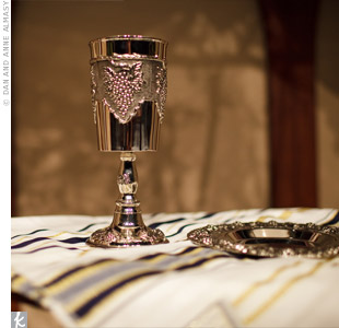 For the communion, the couple used a silver goblet, plate, and prayer shawl that the bride's parents had brought back from Israel.