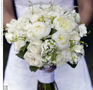 Jill's mom made her elegant bouquet of white hydrangeas, garden roses, peonies, freesia, and lily of the valley with parrot tulips.