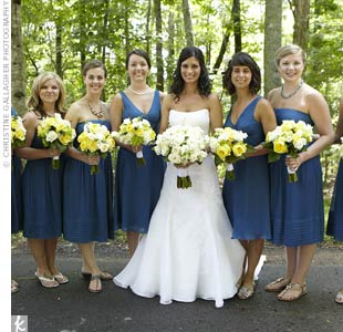The matron and maid of honor stood out in v-neck versions of the bridesmaids' blue silk-chiffon dresses.