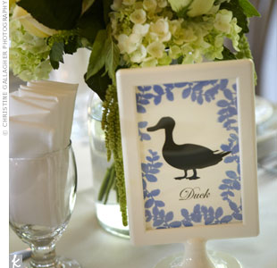 The bridesmaids helped Jill stamp and emboss the forest friend table numbers and then slipped them into white picture frames.