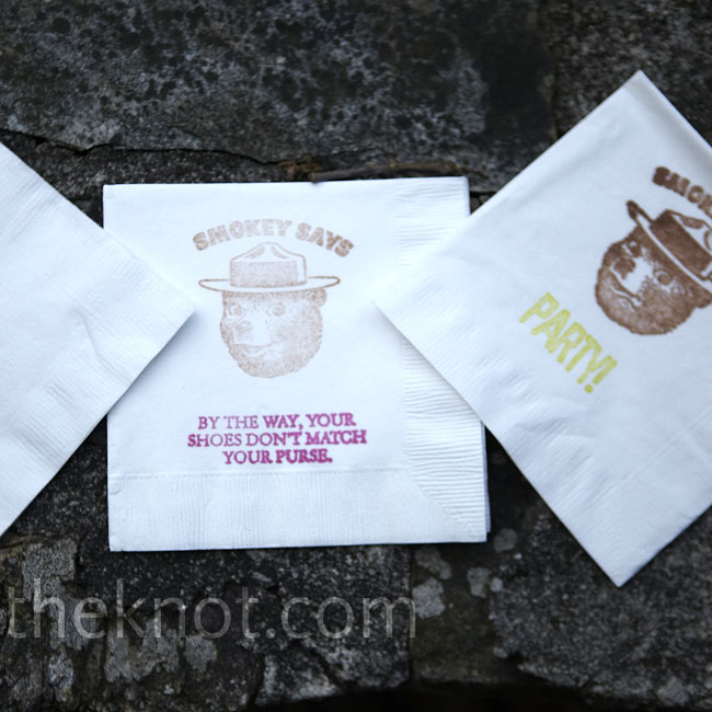 The couple stamped their cocktail napkins with funny phrases and Smokey the Bear -- the icon that greets guests to Lake Tamarack.