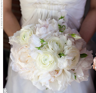 Sylvias bouquet included blush and cream peonies, sweet peas, and ranunculus. For a personal touch, she pinned one of her mothers brooches onto the stems.