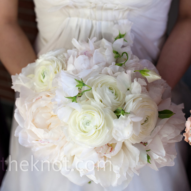 Sylvia's bouquet included blush and cream peonies, sweet peas, and ranunculus. For a personal touch, she pinned one of her mother's brooches onto the stems.