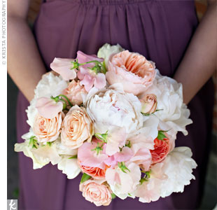 The bridesmaid bouquets were inspired by the flowers of the day -- sweet peas, garden roses, French tulips, and lilac.