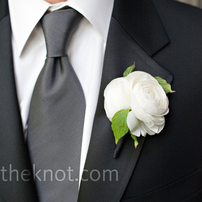Richard and his three groomsmen all wore black tuxes with a notched collar, a deep grey tie, and suspenders instead of vests. Ranunculus and rose blooms popped from their lapels.