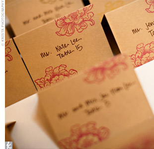 The couple made their own escort cards using a floral stamp and cardstock. Sylvia wrote guests' names on the cards.