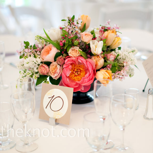 Fresh peonies, French tulips, and garden roses graced half the tables, while the other half had pillar candles surrounded by garden roses.