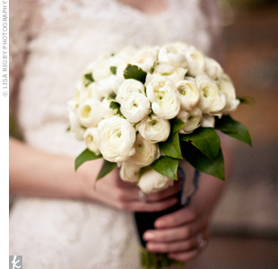 For her bouquet, Erica went with white ranunculus instead of traditional roses. She tied the flowers with a black ribbon for a vintage look.