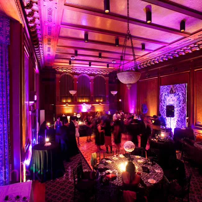 The ballroom was flooded with dramatic red lighting and the staircase was lined with  LED votives.