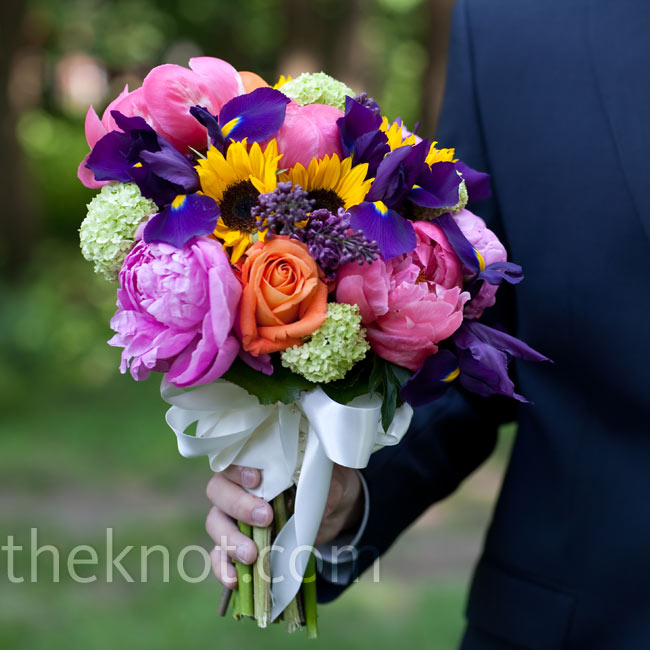 Karen wanted her bouquet to be as bright and colorful as possible. Her florist used peonies, lilacs, irises, and mini sunflowers.