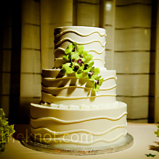 The couple opted for a three-tiered buttercream cake with key lime mouse filling. Fresh cymbidium orchids finished it off.