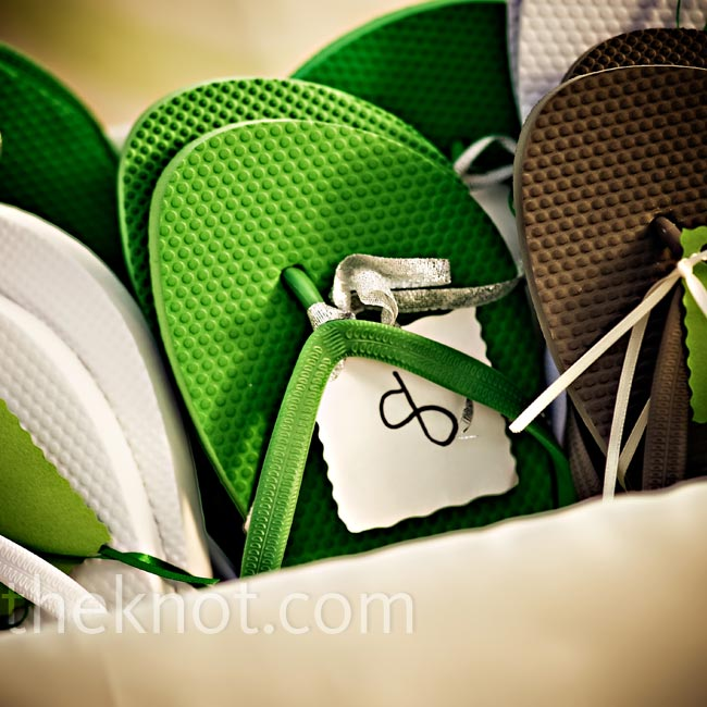To make guests more comfortable on the sand, the couple handed out green, brown and white flip-flops. Also up for the taking: lime-colored luggage tags.