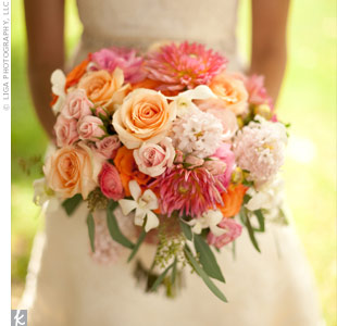 I wanted lots of color, says Abby. Her florist created a bouquet of orange, peach, pale pink, and green flowers (roses, dahlias, ranunculus, hyacinths, and hydrangeas).