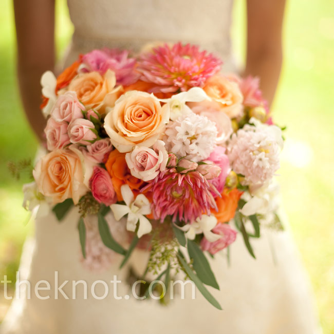 """I wanted lots of color,"" says Abby. Her florist created a bouquet of orange, peach, pale pink, and green flowers (roses, dahlias, ranunculus, hyacinths, and hydrangeas)."