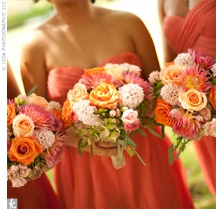 The bridesmaids carried smaller versions of colorful Abbys bridal bouquet.