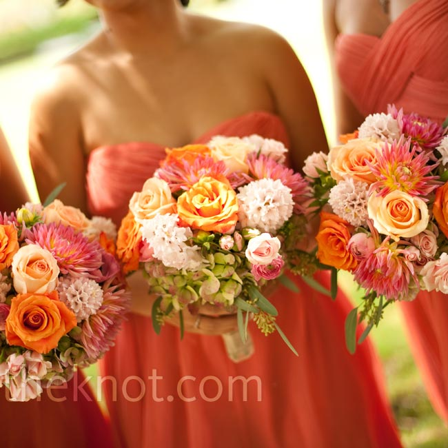 The bridesmaids carried smaller versions of colorful Abby's bridal bouquet.