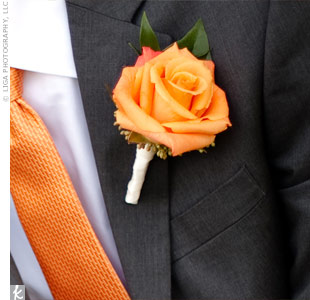 A single orange rose was wrapped with ivory ribbon and pinned to Kyles lapel.