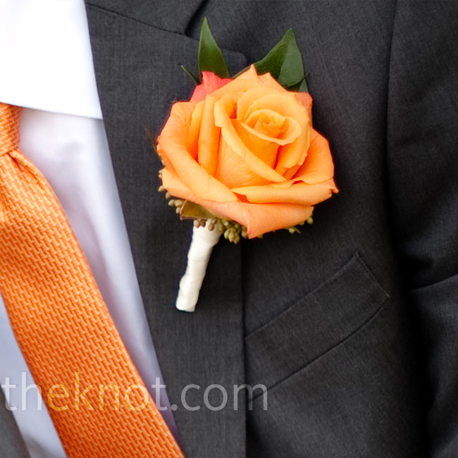 A single orange rose was wrapped with ivory ribbon and pinned to Kyle's lapel.