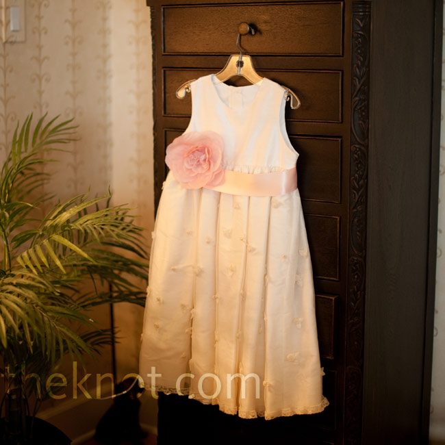 A family friend made the flower girls their tea-length dresses, accented with a pink ribbon sash and flower.