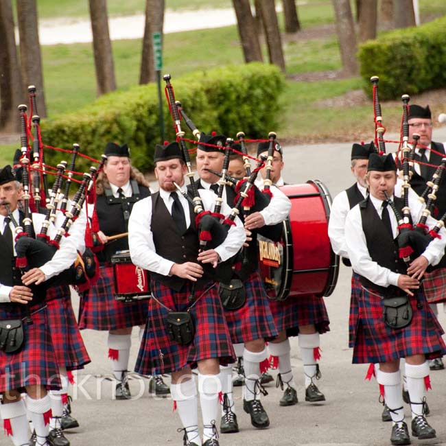 "Abby's parents arranged for a surprise: a full bagpipe band. The band appeared at the end of the ceremony and played ""Amazing Grace"" while guests looked on in awe."