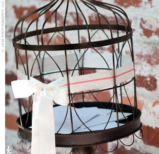 Guests dropped their well wishes into this wrought-iron pedestal birdcage.