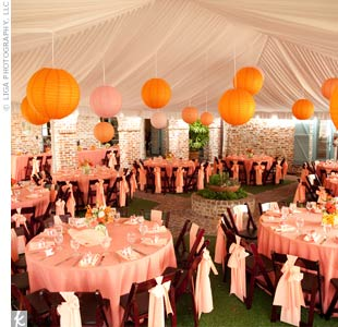 Inside the fabric-draped tent were colorful paper lanterns and coordinating linens.