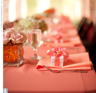 The tables were set with pink napkins and little boxes of chocolates.