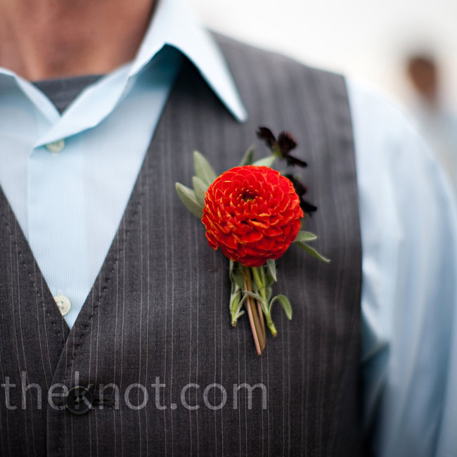 The groom wore a bright red pom-pom dahlia pinned to his lapel.